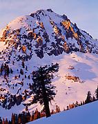 Warm light of a winter sunset illuminating unnamed peak of the Sierra Nevada northeast of Aster Lake, Sequoia National Park, California.