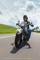 Mark Hill riding his 1936 Indian Four during Stage 1 of the Motorcycle Cannonball Cross-Country Endurance Run, which on this day ran from Daytona Beach to Lake City, FL., USA. Friday, September 5, 2014.  Photography ©2014 Michael Lichter.