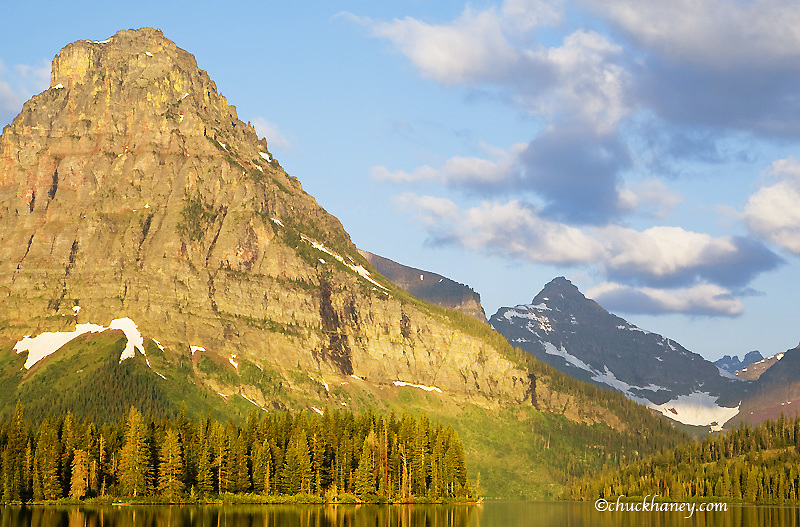 Paddling a sea kayak on a calm Two Medicine Lake in Glacier National Park in Montana