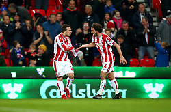 """Stoke City's Xherdan Shaqiri (left) celebrates scoring his side's first goal of the game during the Premier League match at the Bet35 Stadium, Stoke. PRESS ASSOCIATION Photo Picture date: Saturday December 2, 2017. See PA story SOCCER Stoke. Photo credit should read: Dave Thompson/PA Wire. RESTRICTIONS: EDITORIAL USE ONLY No use with unauthorised audio, video, data, fixture lists, club/league logos or """"live"""" services. Online in-match use limited to 75 images, no video emulation. No use in betting, games or single club/league/player publications"""