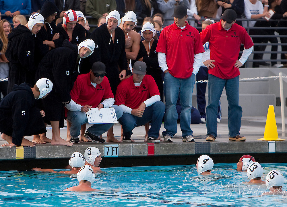 /Andrew Foulk/ For The Californian/.Murrieta Valley boys water polo head coach Bryan Lynton, left, runs through some plays with his team during the teams last timeout before their 11-10 loss to Corona Del Mar during the CIF SS Division II final match.