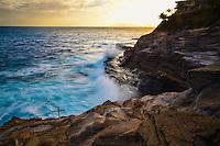 Waves crashing on the shore of Oahu