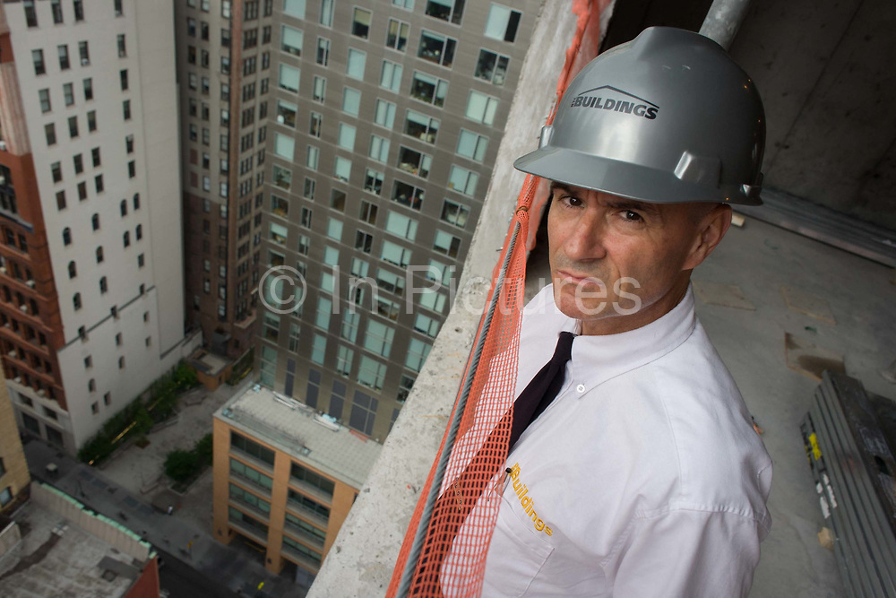 Investigative Engineering Services, Assistant Commissioner Tim Lynch inspecting a new construction site in Manhattan, New York City. With a vertical drop of hundreds of feet, Tim works in the prevention of damage to old and ensuring new buildings are up to standard plus often, assessing the status of a collapsed structure. From the chapter entitled 'The Skyline' and from the book 'Risk Wise: Nine Everyday Adventures' by Polly Morland (Allianz, The School of Life, Profile Books, 2015).