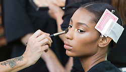 © Licensed to London News Pictures. 13/09/2014. London, England. A model in make-up. Backstage before the Julien Macdonald London Fashion Week catwalk show at the Royal Opera House. Photo credit: LNP