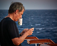 Sunrise Breakfast Club. Coffee While Texting. Image taken with a Nikon 1 V3 camera and 70-300 mm VR lens