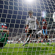 Besiktas's Manuel Fernandes (Not Pictured) scores with ibrahim Toraman (C) and Trabzonspor's goalkkeeper Onur Recep Kivrak seen during their Turkish Superleague soccer derby match Besiktas between Trabzonspor at the Inonu Stadium at Dolmabahce in Istanbul Turkey on Sunday, 21 October 2012. Photo by TURKPIX