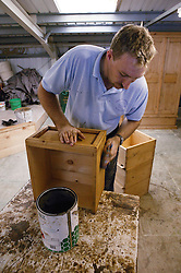 Man with learning disabilities making pine furniture,