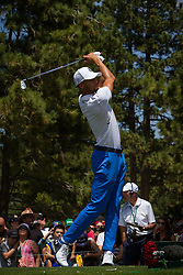 July 15, 2018 - Stateline, Nevada, U.S - Golden State Warriors All-Star guard, STEPHEN CURRY, drives from the 17th hole during the 29th annual American Century Championship at the Edgewood Tahoe Golf Course in Stateline, Nevada, on Sunday, July 15, 2018. (Credit Image: © Tracy Barbutes via ZUMA Wire)