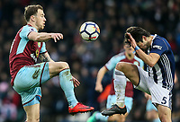 Burnley's Ashley Barnes competing with West Bromwich Albion's Claudio Yacob<br /> <br /> Photographer Andrew Kearns/CameraSport<br /> <br /> The Premier League - West Bromwich Albion v Burnley - Saturday 31st March 2018 - The Hawthorns - West Bromwich<br /> <br /> World Copyright © 2018 CameraSport. All rights reserved. 43 Linden Ave. Countesthorpe. Leicester. England. LE8 5PG - Tel: +44 (0) 116 277 4147 - admin@camerasport.com - www.camerasport.com