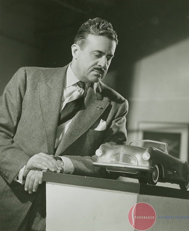 Raymond Loewy poses with an eight-scale clay model c.1945.