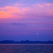Detail of clouds and moonrising over Coronado island in Loreto. Baja California Sur, Mexico.