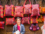 07 APRIL 2013 - CHIANG MAI, CHIANG MAI, THAILAND:  A handbag vendor with her merchandise in the Chiang Mai Walking Street market. The Walking Street Market starts at Thapae Gate and runs along the length of Ratchadamnoen Road through the heart of the Old City and has become a Chiang Mai institution. Chiang Mai is the largest town in northern Thailand and is popular with tourists and backpackers.       PHOTO BY JACK KURTZ