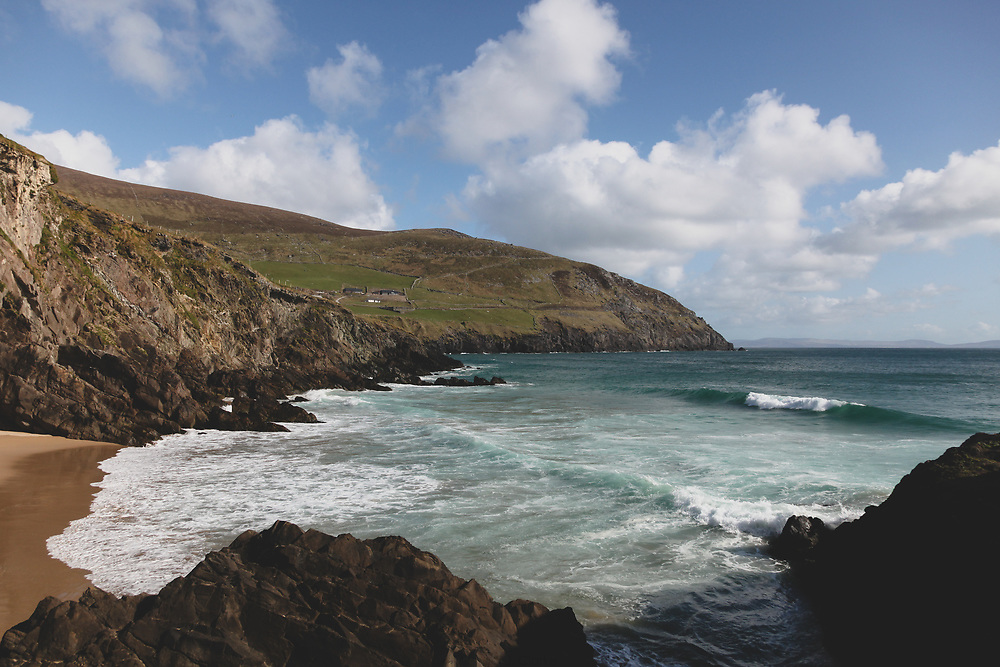 The pristine landscape of the Atlantic Ocean meeting the rocky shores of Ireland at Coumeenoole Beach.