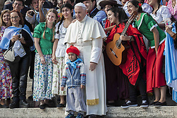 October 19, 2016 - Vatican City, Vatican - Pope Francis poses for a photo during his Weekly General Audience in St. Peter's Square in Vatican City, Vatican. Pope Francis on Wednesday said access to food and water is a basic human right, and called on believers and people of good will everywhaere to take personal responsibility for the needs of their neighbors. (Credit Image: © Giuseppe Ciccia/Pacific Press via ZUMA Wire)