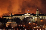 Moscow, Russia, 14.03/2004..Two firemen died fighting a huge blaze which engulfed the Manezh exhibition hall, one of Russia's most historic buildings, located only yards from the Kremlin. Flames and smoke billow from the hall behind the Kremlin.