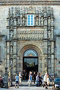Tourists at Parador Hotel - Hostal de Los Reyes Catolicos in Santiago de Compostela, Galicia, Spain