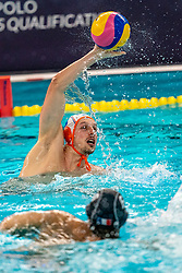 Jesse Nispeling of the Netherlands in action against Enzo Khasz of France during the Olympic qualifying tournament. The Dutch water polo players are on the hunt for a starting ticket for the Olympic Games on February 17, 2021 in Rotterdam