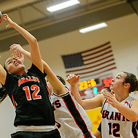 101615  Adron Gardner/Independent<br /> <br /> Gallup Bengal Kristen Quigley (12), left, pulls down a rebound from Grants Pirates Christina Moleres (3) and Jordan Woodbury (12) at Grants High School Friday