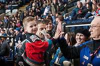 KELOWNA, CANADA - DECEMBER 6: A fan gives a high five to the usher on December 6, 2013 at Prospera Place in Kelowna, British Columbia, Canada.   (Photo by Marissa Baecker/Shoot the Breeze)  ***  Local Caption  ***