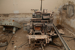 © licensed to London News Pictures. TRIPOLI, LIBYA  19/02/12. An old British made Linotype printing press in a buknker in Bab Al Azizia, Muarmar Gaddafi's former compound in Tripoli, Libya. Much of it was destroyed by NATO bombing. Please see special instructions for usage rates. Photo credit should read MICHAEL GRAAE/LNP