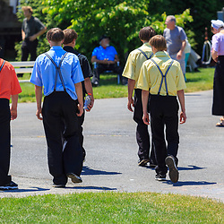 Intercourse, PA - June 18, 2016: Amish teenage boys walking in the Community Park at the Intercourse Heritage Days event.