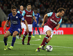 Mark Noble of West Ham United (R) in action  - Mandatory byline: Jack Phillips/JMP - 07966386802 - 22/09/2015 - SPORT - FOOTBALL - Leicester - King Power Stadium - Leicester City v West Ham United - Capital One Cup Round 3