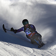 Peter Dunning, Great Britain, in action during the Men's Giant Slalom Sitting, Adaptive competition at Coronet Peak, New Zealand during the Winter Games. Dunning, who lost both his legs in a roadside bombing attack in Afghanistan three years ago. Winter Games, Queenstown, New Zealand, 25th August 2011. Photo Tim Clayton..