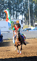 The Mexican flag debuts during the Pageant of the Flags on Friday night at the 102nd California Rodeo Salinas, which opened July 19 for a four-day run.