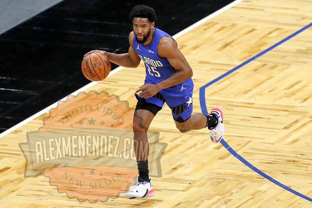 ORLANDO, FL - APRIL 18: Chasson Randle #25 of the Orlando Magic controls the ball against the Houston Rockets at Amway Center on April 18, 2021 in Orlando, Florida. NOTE TO USER: User expressly acknowledges and agrees that, by downloading and or using this photograph, User is consenting to the terms and conditions of the Getty Images License Agreement. (Photo by Alex Menendez/Getty Images)*** Local Caption *** Chasson Randle
