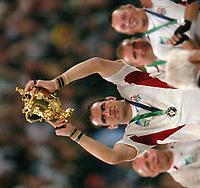 Photo: Richard Lane.<br />Australia v England. Rugby World Cup Final, at the Telstra Stadium, Sydney. RWC 2003. 22/11/2003. <br />Martin Johnson holds aloft the Webb Ellis Trophy as England win the Rugby World Cup.
