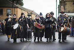 January 14, 2017 - Whittlesey, Cambridgshire, UK - Whittlesey UK. Picture shows members of the Witchmen Molly dancers at the 38th Whittlesey Straw Bear Festival this weekend. In times past when starvation bit deep the ploughmen of the area where drawn to towns like Whittlesey, They knocked on doors begging for food & disguised their shame by blackening their faces with soot. In Whittlesey it was the custom on the Tuesday following Plough Monday to dress one of the confraternity of the plough in straw and call him a Straw Bear. The bear was then taken around town to entertain the folk who on the previous day had subscribed to the rustics, a spread of beer, tobacco & beef. The bear was made to dance in front of houses & gifts of money, beer & food was expected. (Credit Image: © Andrew Mccaren/London News Pictures via ZUMA Wire)