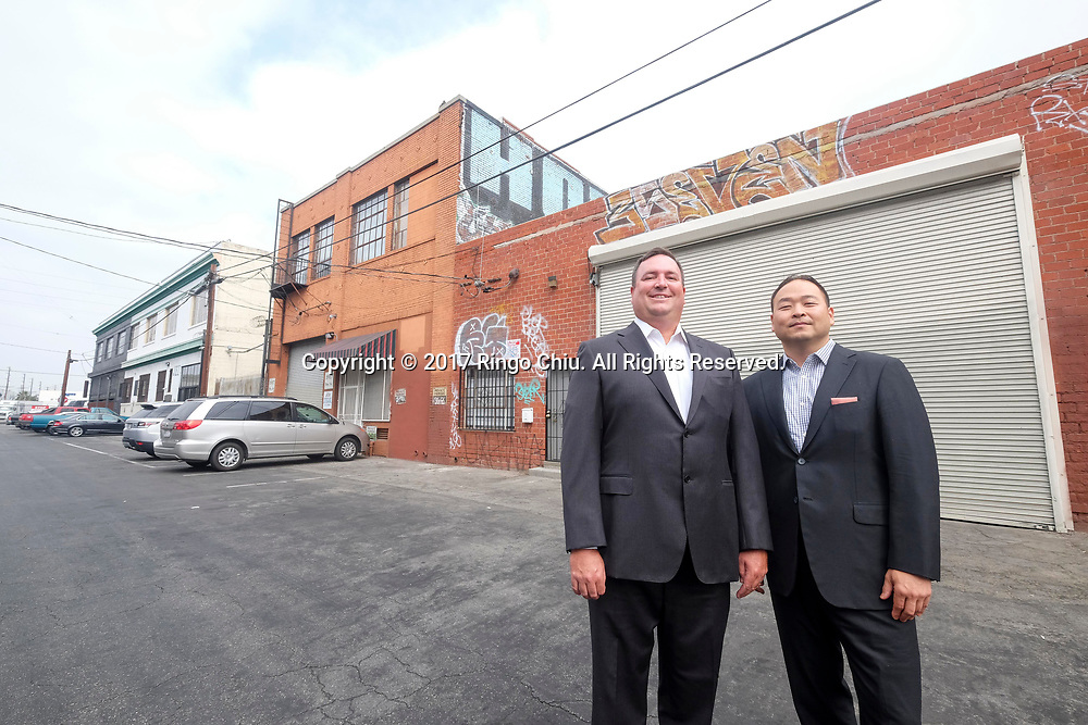 Jae Yoo and Brandon Gill, executive directors at Cushman & Wakefield, at a commercial property in the Arts District.  (Photo by Ringo Chiu)<br /> <br /> Usage Notes: This content is intended for editorial use only. For other uses, additional clearances may be required.