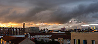 Panoramic view over the Gorbals towards Glasgow city centre as  the sun sets