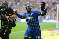 Adebayo Akinfenwa of AFC Wimbledon celebrates his teams win after the final whistle. Skybet football league two play off final match, AFC Wimbledon v Plymouth Argyle at Wembley Stadium in London on Monday 30th May 2016.<br /> pic by John Patrick Fletcher, Andrew Orchard sports photography.