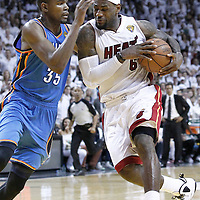 21 June 2012: Miami Heat small forward LeBron James (6) drives past Oklahoma City Thunder small forward Kevin Durant (35) during the Miami Heat 121-106 victory over the Oklahoma City Thunder, in Game 5 of the 2012 NBA Finals, at the AmericanAirlinesArena, Miami, Florida, USA. The Miami Heat wins the series 4-1.