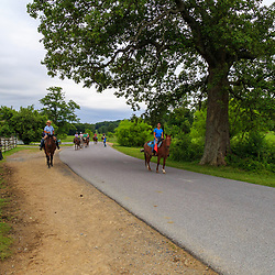 Gettysburg, PA, USA - June 20, 2018: A group on a horseback tour of the battlefield approach the General Sickles marker, showing where he was wounded on the second day of fighting.