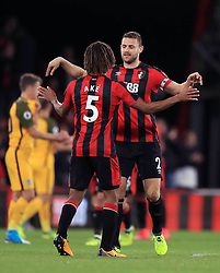 AFC Bournemouth's Simon Francis and Nathan Ake celebrate victory after the final whistle of the Premier League match at the Vitality Stadium, Bournemouth.