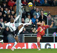 Photo: Gareth Davies.<br />Fulham v Reading. The Barclays Premiership. 25/11/2006.<br />Fulham's Luis Boa Morte (L) and Reading's Greame Murty (R) both challenge for the ball in the air.