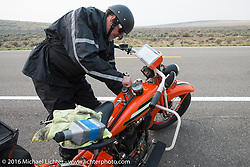"""Randy Aron working roadside on his 1929 Harley-Davidson JD named """"Lucille"""" during Stage 13 (257 miles) of the Motorcycle Cannonball Cross-Country Endurance Run, which on this day ran from Elko, NV to Meridian, Idaho, USA. Thursday, September 18, 2014.  Photography ©2014 Michael Lichter."""