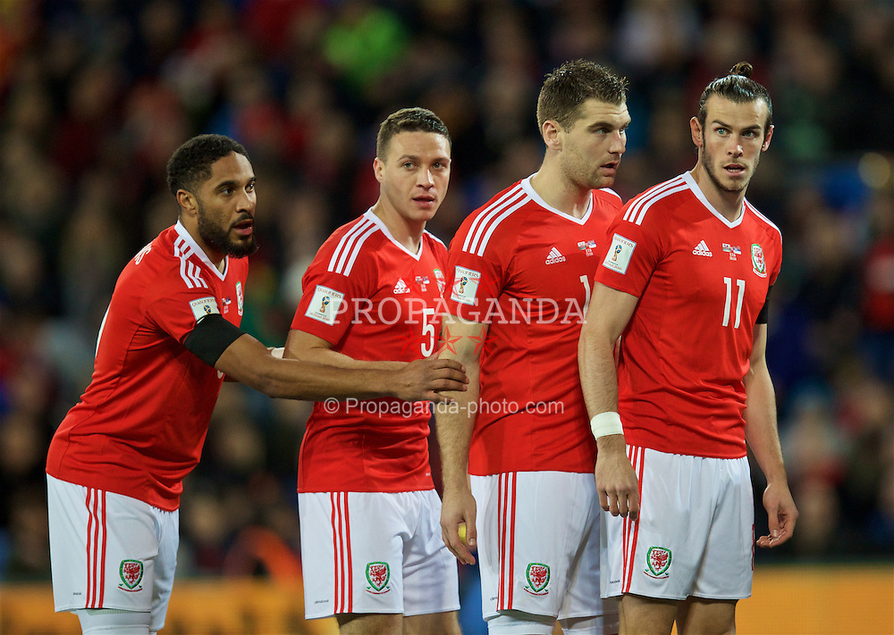CARDIFF, WALES - Saturday, November 12, 2016: Wales' captain Ashley Williams, James Chester, Sam Vokes and Gareth Bale in action against Serbia during the 2018 FIFA World Cup Qualifying Group D match at the Cardiff City Stadium. (Pic by David Rawcliffe/Propaganda)