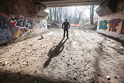 Kevin Langan with his hut on the wasteground near Ibrox. He has set himself the challenge of building 100 small huts on any land where they can be made from the natural resources. Pic in underpass near the site.