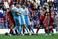Sunderland defender Tom Flanagan (12) is restrained as Sunderland midfielder Lee Cattermole (6) lays on the floor  during the EFL Sky Bet League 1 match between Bradford City and Sunderland at the Northern Commercials Stadium, Bradford, England on 6 October 2018.