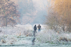 ©Licensed to London News Pictures 04/12/2019.<br /> Sidcup,UK. School children walking to school across a frozen field. The Met office has issued a cold weather warning as air from the Arctic will see temperatures in the UK drop this week. The freezing cold weather conditions this morning at Footscray Meadows in Sidcup, South East London. Photo credit: Grant Falvey/LNP