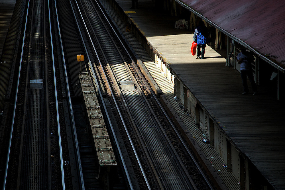 A traveler awaits the next train on the platform of the Madison/Wabash station in Chicago.v