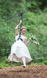 Colette Gregory after tying the knot in the trees at Go Ape Aberfoyle, heading down another zip wire, after the climbing net.