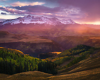 Sunset light filters through virga over Wilson Peak, Telluride, Colorado, USA
