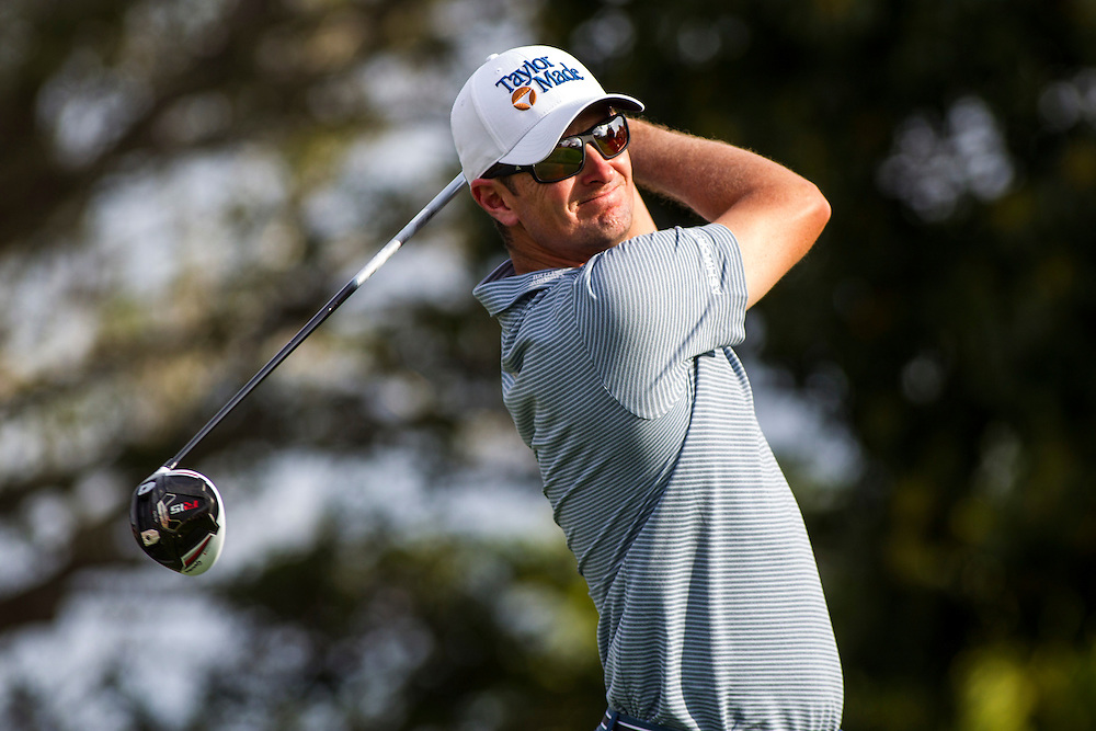Feb 26, 2015; Palm Beach Gardens, FL, USA; Justin Rose tees off on the 14th hole during the first round of the Honda Classic at PGA National GC Champion Course. Mandatory Credit: Peter Casey-USA TODAY Sports