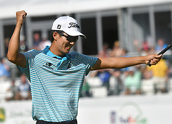 July 15, 2018 - Silvis, Illinois, U.S. - SILVIS, IL - JULY 15:  Michael Kim reacts after winning the John Deere Classic on July 15, 2018, at TPC Deere Run, Silvis, IL.  (Photo by Keith Gillett/Icon Sportswire) (Credit Image: © Keith Gillett/Icon SMI via ZUMA Press)