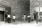 Young African - American boys eye a stranger at Techwood Homes an Atlanta public housing project. Many children roam the projects without aduly supervision both day and night, making most wary of newcomers during the period of The Atlanta  Child Murders.