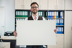 Young man office holding poster sign advert